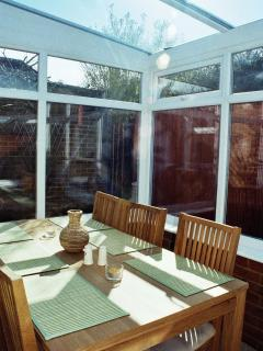Lovely conservatory diner for a relaxing sit together.