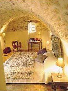 A cosy bedroom with original vaulted ceiling