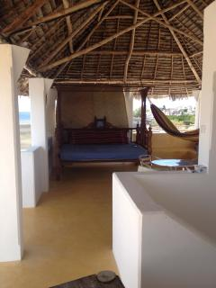 Rooftop space with a queen size bed/seater and a hammock.  A place to 'chillax' and enjoy.