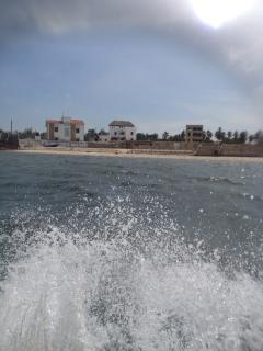 5 minute speed boat ride to Manda Airport.