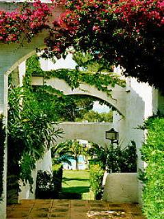 One of two gated entrances to shared garden & pool.  The entrance to  Las Piñas is on level ground.