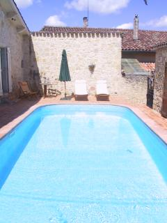 The courtyard swimming pool is a real sun-trap, parasol provided for shade when required
