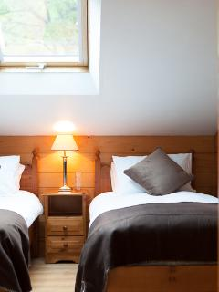 Cosy twin - beds can be pushed together for couples
