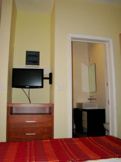 TV from the bed and bathroom entrance