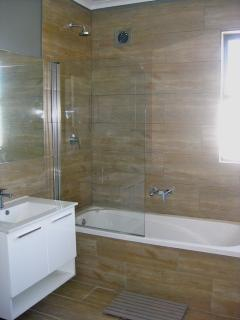 New bathrooms with wood-look tiling, imported fittings and sanitaryware