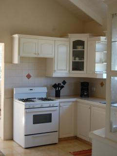 Attractive,spacious Kitchen well equipped  with all modern amenities. Laundry room behind kitchen