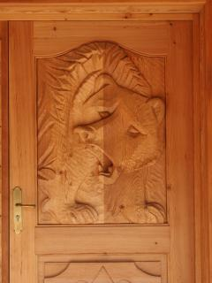 A local sculptor hand carved the Bear Front Door. He looks ferocious, rest assured, we are friendly!