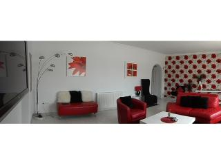 bright and airy modern decor with a wide screen wall mounted TV