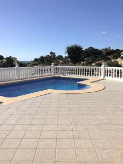 Large terrace with pool and sea view beyond