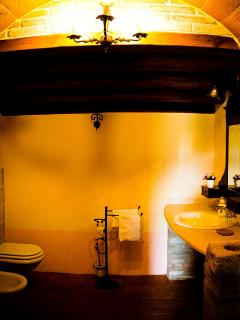 Large bathroom obtained from an ancient cave tuff