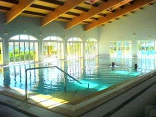 Heated Indoor Pool, with Jacuzzi, leading out to the bistro and outdoor pool area