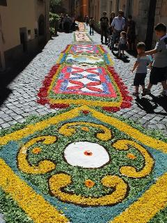 Corpus Domini, flower petal decorations throughout the old town, Palestrina