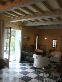 Living room with two large french doors to terrace