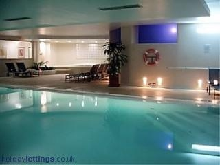 The luxurious indoor pool , jacuzzi and sauna