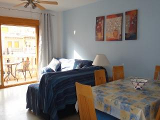 Our bright and airy Lounge/Dining room leading on to balcony. Hot and cold air conditioning.