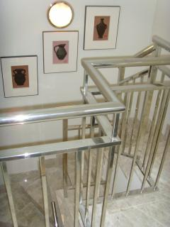 Staircase from apartment up to a top private sun terrace.