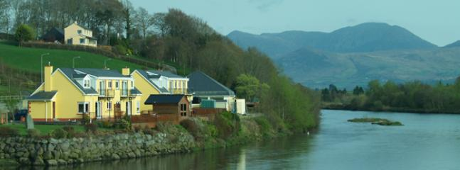 Riverside Holiday Homes riverbank location with panoramic views