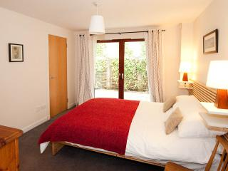 main bedroom with patio doors leading to small private terrace