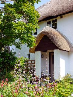 The cottage, as seen from a sunbathing position on the grass!