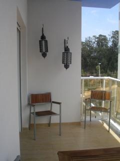 relax on the balcony overlooking the pool