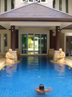 Looking from swimming pool to front door