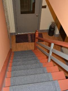 Stairs leading down and towards the front door.