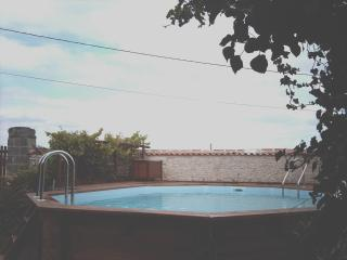 Swimming pool and decking fom the garden