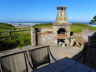 An outside fireplace and picnic area