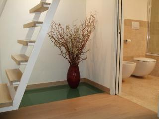 Stairs to roof terrace, beautiful wood and marble throughout apartment