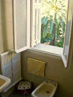 Spacious Bathroom with toilet, sink, bidet and full size bath with shower head