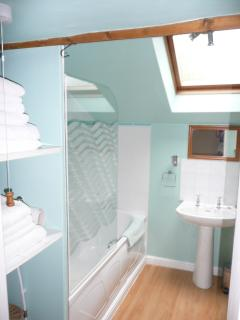 bathroom with shower and bath - towels provided