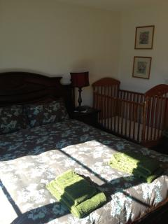 Balcony bedroom with cot for baby