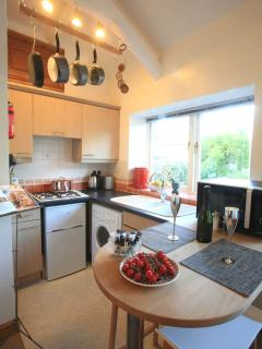 The compact kitchen has everything to cater for four