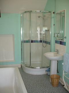 Family bathroom with bath and walk in shower.