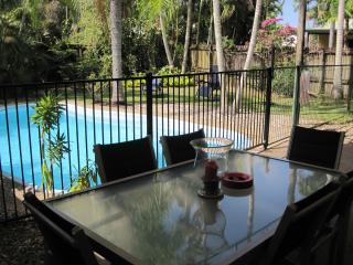 Outdoor area near BBQ and pool for elfresco dining or just having a drink while watching the childre