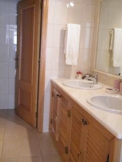 En suite to master bedroom with his and hers sinks