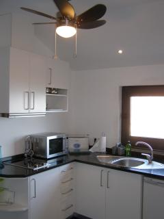 Fitted kitchen with halogen hob, microwave, toaster, coffee machine & remote controlled ceiling fan