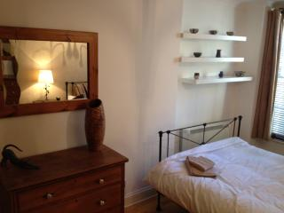 Double bedroom with sash window. Sink into our Egyptian cotton bedding....