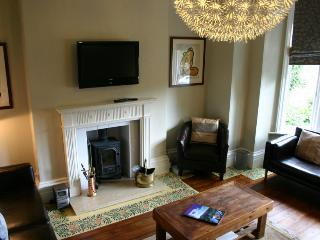 Comfortable sitting room with seating for 12 and freeview TV.