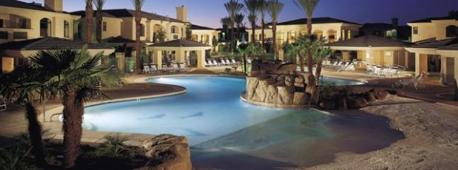 Resort style amenities with lush palms and fountains
