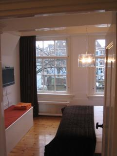 Master Bedroom with Flatscreen and View on Canal
