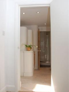 Hallway from living room to bathroom.