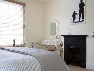 Bedroom 1 - Traditional fireplaces with Urban artwork