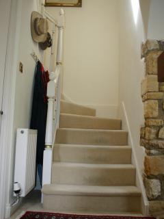 Wide stairs with hand rail. Downstairs w/c
