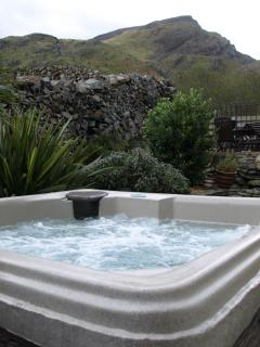 Relax in the hot tub with stunning mountain views