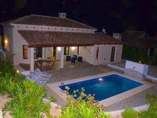 Enjoy the cool evenings by the pool and large private grounds