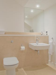 Spacious bathroom with bath over shower and plenty of space