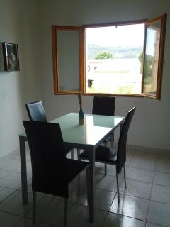 dining area with view through window across valley