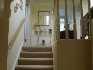 from the private door way through the porch landing and up the stair case to the two bedroom