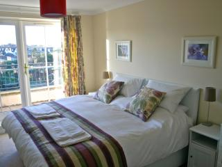 master bedroom with en-suite and small balcony
